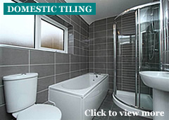 Photo of a domestic bathroom wall and floor tiling
